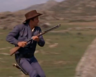 Cowboy with rifle from White Commanche film